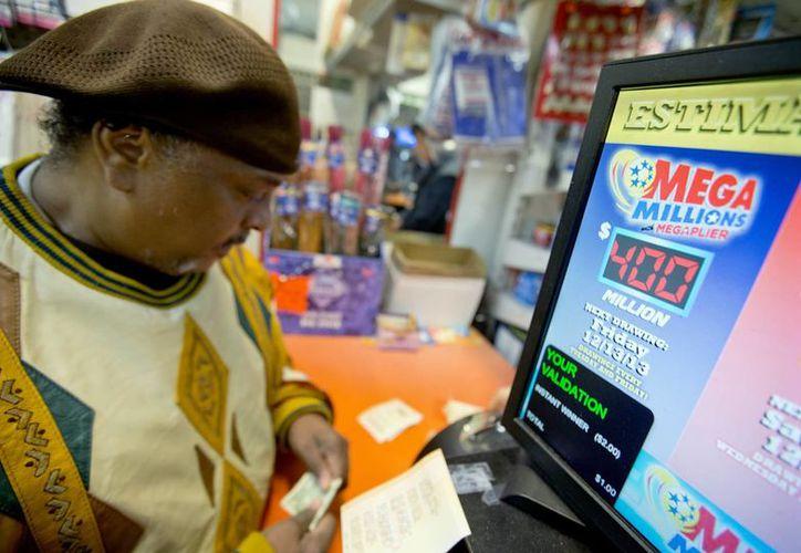 La lotería Mega Millions se juega en 43 estados, el Distrito de Columbia y en las Islas Vírgenes estadunidenses. (Agencias)