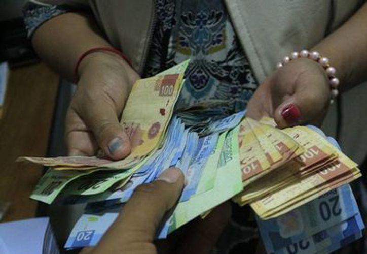 Recientemente entró en vigor la disposición de tener un salario mínimo único en el país, de 70.10. (Ángel Castilla/SIPSE)