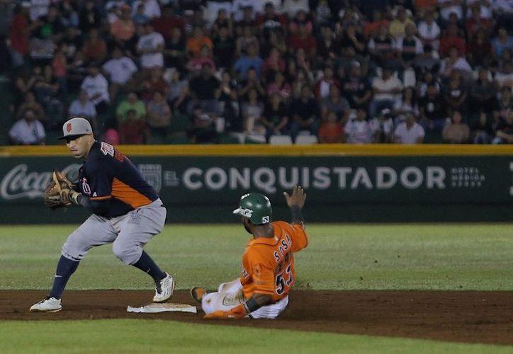 La disputa salvaje entre Leones y Tigres favoreció a los melenudos, en un trepidante y decisivo séptimo juego, en Yucatán, por pizarra de 6-5, para convertirse en campeón de la Zona Sur. (Redacción/SIPSE)