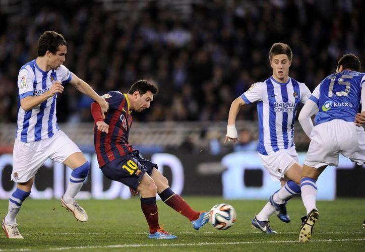 Messi abrió el marcador (foto) y llegó a 335 goles con la camiseta del Barcelona. (Agencias)