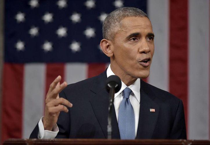 Ante un Congreso dominado por republicanos, Obama prometió colaborar con ellos hacia una mejor política en el país. (AP)