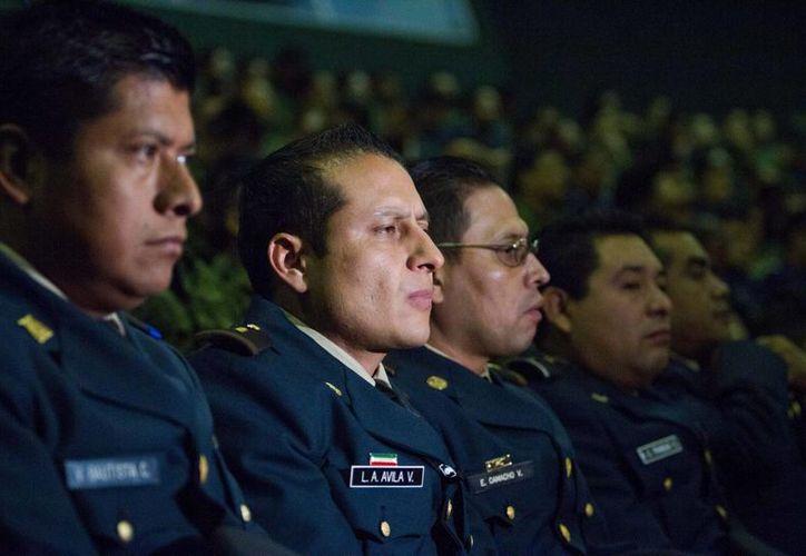 No solo hubo ascenso a generales, sino también a coroneles , capitanes y otros. (Notimex/Foto de contexto)