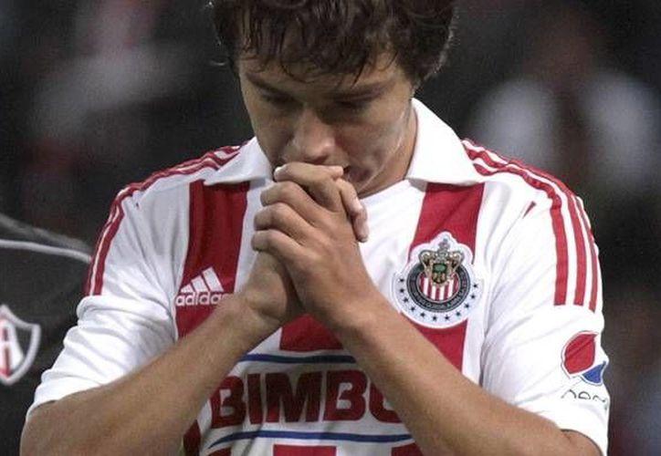 'Cubo' Torres sufrió una caída y se lesionó. (Mexsport)