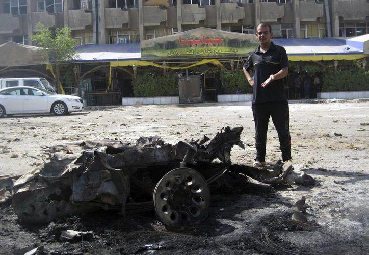 Zona de un atentado, cerca de un restaurante en Talbiya, Irak. (EFE)