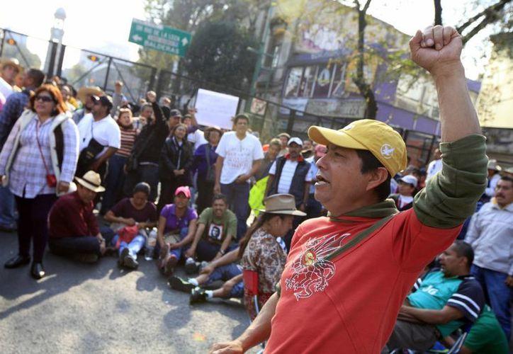 Los integrantes de la CNTE aseguran que reorganizarán el plantón, y que su eventual retiro no está a negociación. (Archivo/Notimex)