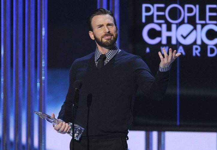 Chris Evan se llevó el premio 'People's Choice' a Mejor Actor en una Película de Acción gracias a su interpretación en el filme 'Capitán América'. (Foto: AP)