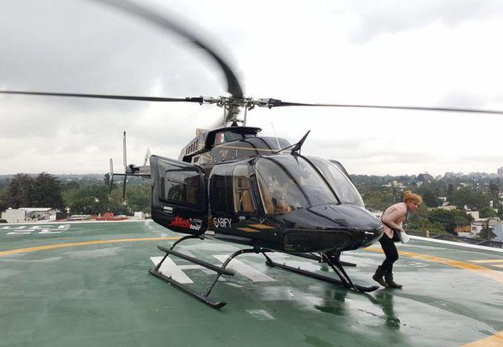 Cabify lanzó este 28 de septiembre de 2016, el servicio Shuttle en la Ciudad de México, el cual realizará vuelos en helicóptero entre el aeropuerto capitalino y Polanco en una primera etapa. (Fotos: Notimex)