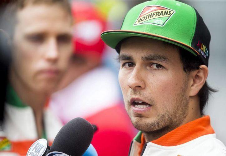 Sergio Pérez se mostró contento por ayudar a su equipo a ubicarse en el segundo lugar del mundial de constructores. (Foto: EFE)