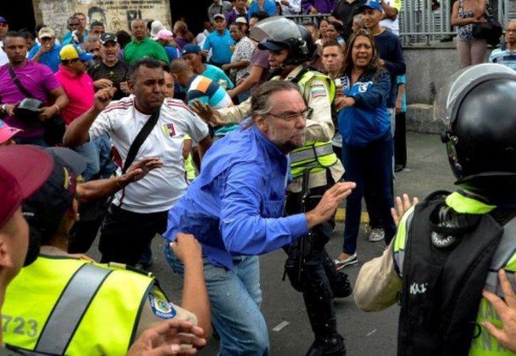Dos nuevas víctimas elevaron a cuatro la cifra de muertos durante protestas contra el gobierno de Nicolás Maduro. (Teletica.com).