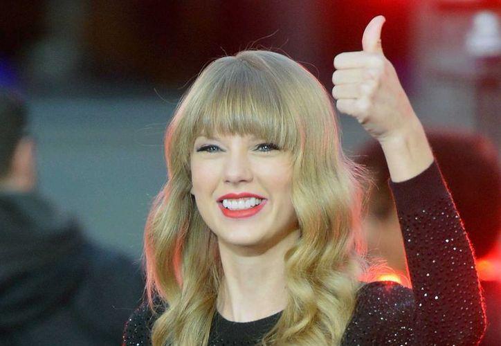 La Policia dijo que el hombre bloqueó el acceso a la casa de Taylor Swift, a quien se ve en la foto. (Agencias)