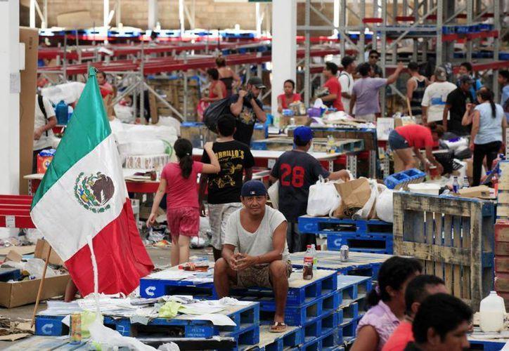 Las autoridades han incautado más de dos mil artículos electrónicos, como pantallas y lavadoras, que fueron saqueados de las tiendas afectadas por el huracán Odile. (Archivo/Notimex)