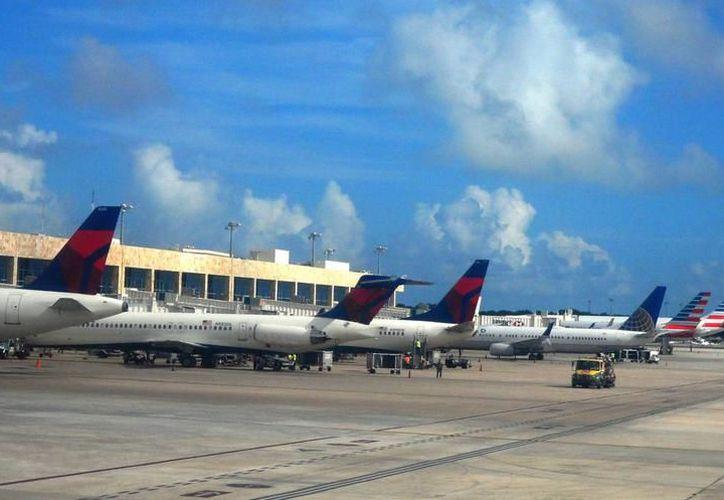 El pasado viernes se cancelaron 12 operaciones internacionales entre Cancún, Miami y La Habana. (Archivo/ SIPSE)