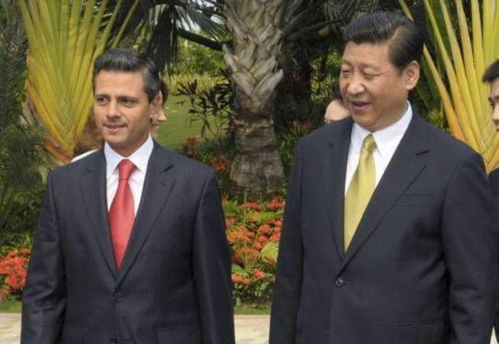 Foto de archivo de los presidentes de China, Xi Jinping, y México, Enrique Peña. que volverán a reunirse este jueves. (Archivo Agencias)