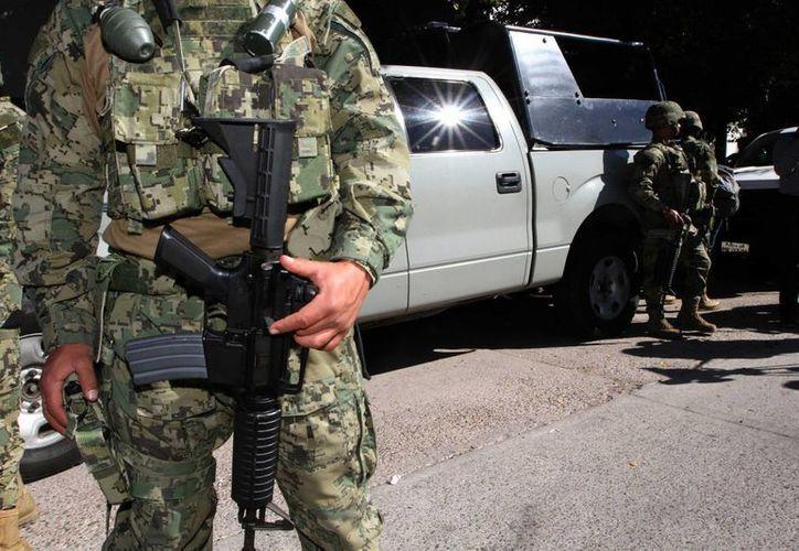 Alto mando militar afirman que los índices de confianza que tienen las fuerzas armadas no ha disminuido. (Archivo/Notimex)