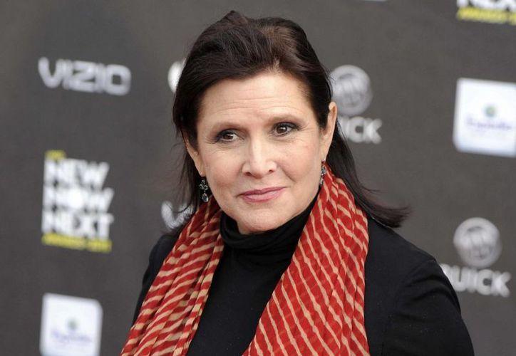 La actriz comentó que está comiendo toda clase de dulces antes de interpretar a la princesa Leia en la próxima entrega de Star Wars . (Agencias)
