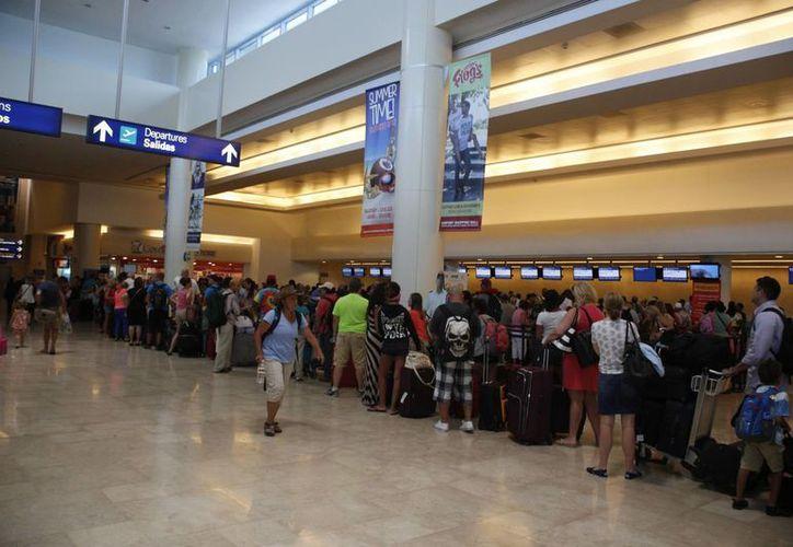 En 2013, llegaron al Aeropuerto Internacional de Cancún 511 mil 815 estadounidenses. (Israel Leal/SIPSE)