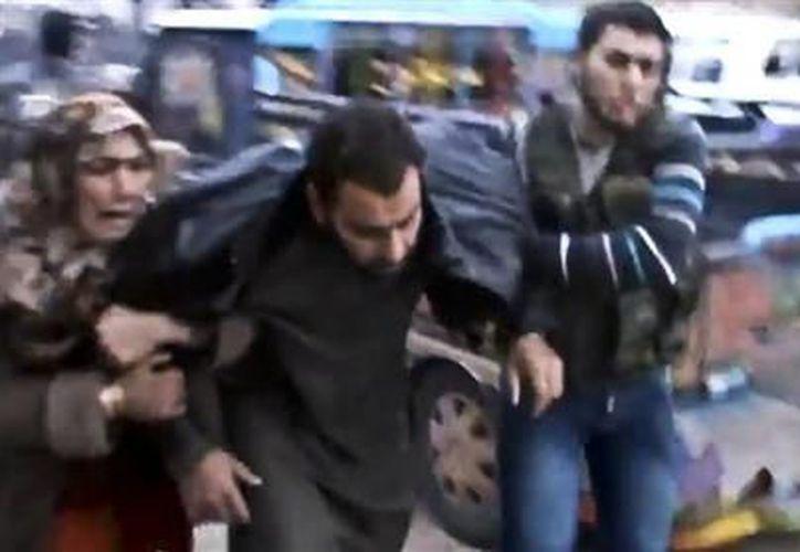 Esta imagen del domingo 23 de diciembre de 2012, tomada de un video obtenido por Shaam News Network. (Agencias)