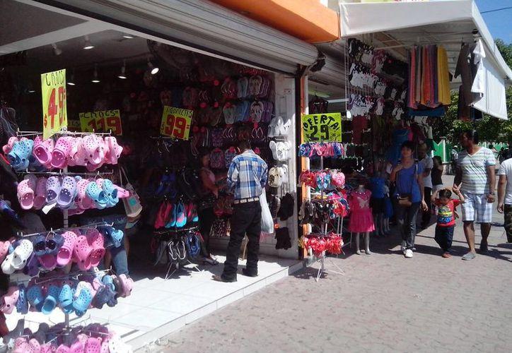 Durante 2015 los pequeños comercios inscritos en el RIF deberán empezar a pagar el 10 % del ISR. (Adrián Barreto/SIPSE)