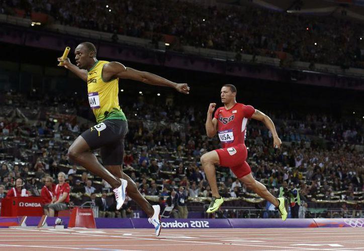 Bolt ganó tres preseas doradas en las pasadas olimpiadas de Londres 2012. (Foto: Archivo)