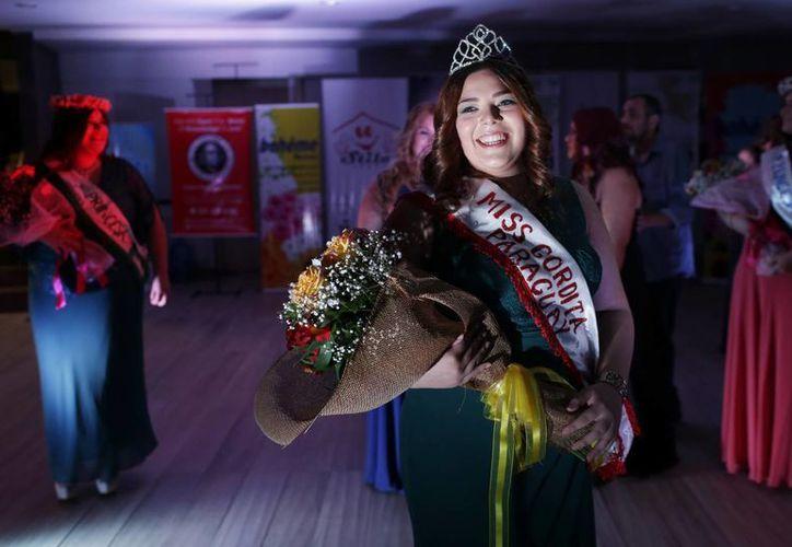 Romina Verna, una hermosa mujer de 23 años y 95 kilos, es la nueva Miss Gordita de Paraguay. (AP)