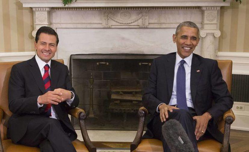 Los presidentes de México, Enrique Peña Nieto, y de EU, Barack Obama, durante su reunión en Washington, para conversar sobre seguridad, inmigración y el Acuerdo Transpacífico de Cooperación Económica (TPP). (Foto: EFE)