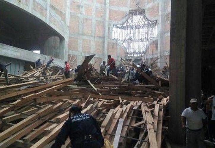 Los cuerpos de los fallecidos por el desplome de la cúpula de la Catedral de Tuxtepec ya fueron entregados a sus familiares. (Archivo/Milenio)