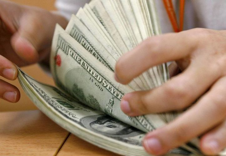 Banxico vendió este mediodía 66 millones de dólares, de los 93 millones de dólares ofrecidos en la segunda subasta con precio mínimo realizada este martes. (Archivo/EFE)