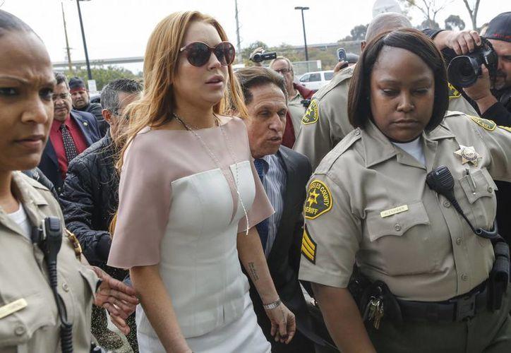 Lindsay Lohan acudió este lunes a un hospital de Estambul para visitar a refugiados sirios, a quienes les hizo algunos regalos. (Imagen de archivo/ AP)