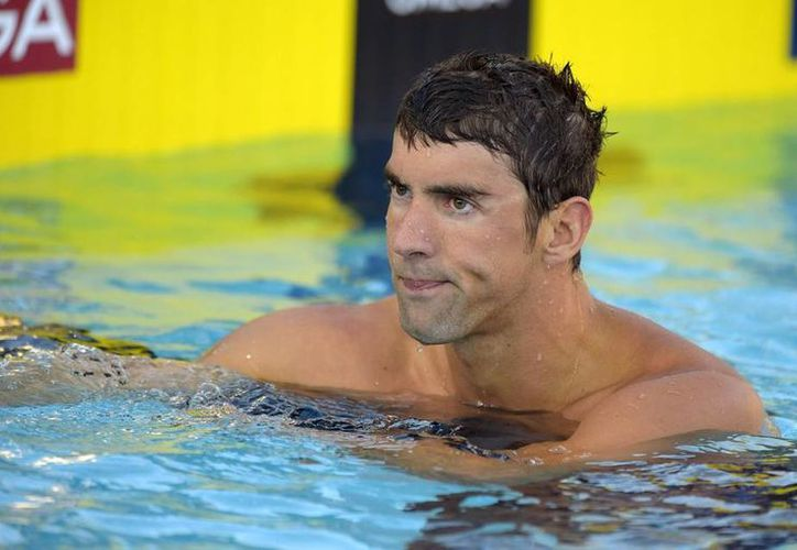 Por estar en rehabilitación, Michael Phelps Phelps se perderá el primer gran premio en Minneapolis. Los cinco grandes premios restantes serán el primer semestre del 2015. (AP)