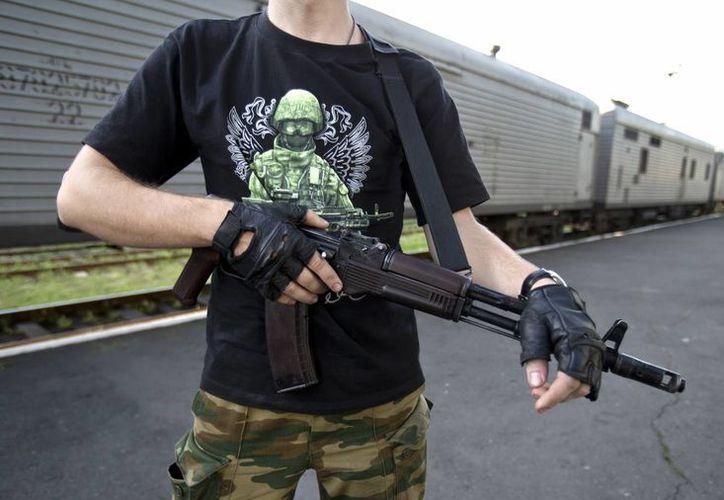 Las conversaciones en poder de la inteligencia ucraniana indican que un rebelde apodado como Khmuryi tiene las cajas negras en su poder. (AP)