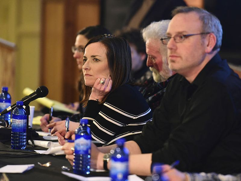Park County School District 6 board chair Kelly Simone, center, listens to members of the community voice their opinions on Policy CKA, which would allow armed personnel in schools.