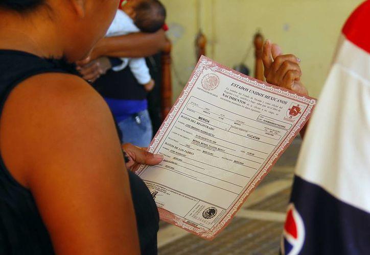 Aumenta la demanda de impresión de actas de nacimiento foráneas en Mérida. Imagen de contexto. (Milenio Novedades)