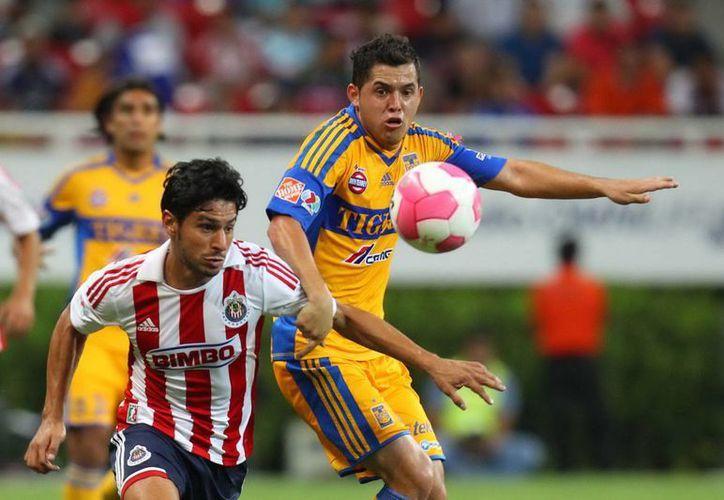 Tigres y Chivas encabezan los grupos Dos y Seis, respectivamente, en el torneo de Copa MX. (Archivo Notimex)