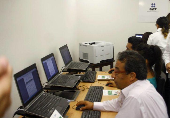 Este año entró en vigor la facturación electrónica en el país. En julio entró en vigor la parte de la contabilidad electrónica, la cual tuvo varias prórrogas. Imágenes de las oficinas del SAT en Mérida (Milenio Novedades)