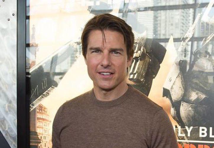 Tom Cruise interpreta al comandante William Cage que lucha contra  poderosos alienígenas en la cinta Edge of tomorrow. (Milenio Novedades)