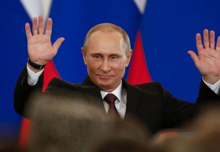 """Putin se reunió con los más ricos de Rusia para decirles """"deberían estar inscritos en territorio de Rusia y pagar impuestos en nuestra patria"""". (Agencias)"""