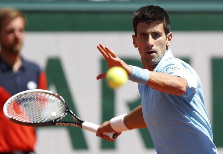 Djokovic eliminó este viernes a Gulbis y el domingo enfrentará en la final a Nadal, con una impresionante racha en el Abierto de Francia donde es el actual tetracampeón. (EFE)