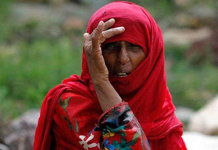 Imagen de una habitante de Socotra; las gente del lugar, aislada del mundo durante muchos años, ha comentado a adquirir costumbres que las hacen abandonar sus raíces y costumbres. (actualidad.rt)