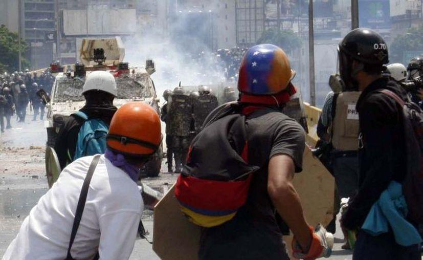 Durante las protestas en Venezuela han perdido la vida 59 personas. (Foto: Notimex)