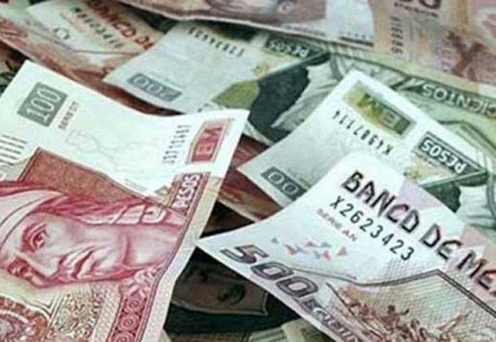 Tener más dinero, el principal propósito de mexicanos para 2015. (Notimex)