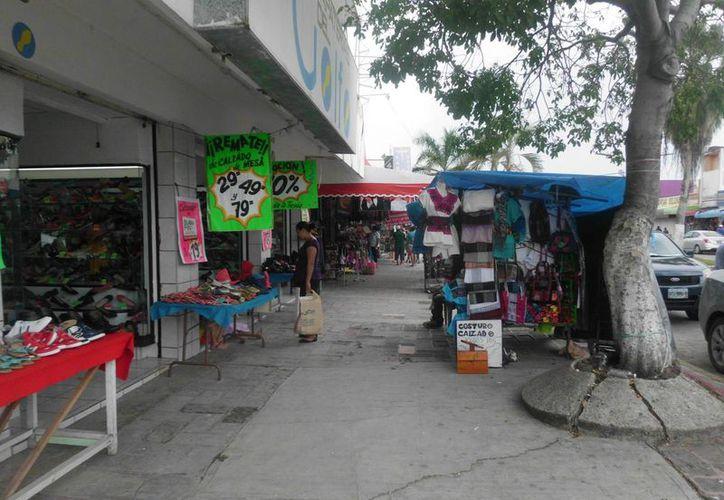 En los establecimientos del centro de la ciudad la afluencia ha sido escasa a pesar de El Buen Fin. (Paloma Wong/SIPSE)