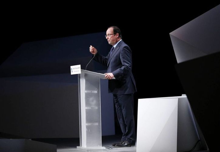 Procupa a Hollande el descenso del poder adquisitivo de los franceses. (EFE)