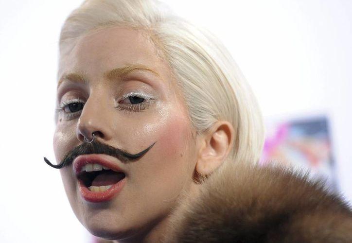 Lady Gaga tendrá que hacer un mes de entrenamiento vocal a causa del cambio de ambiente. (EFE)