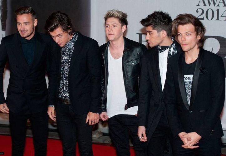 El grupo One Direction está por iniciar su gira internacional en la que su 'bandera' será el nuevo sencillo <i>You and I</i>, que está por salir. La imagen corresponde al grupo en los Brit Awards 2014. (noticias1d.com)