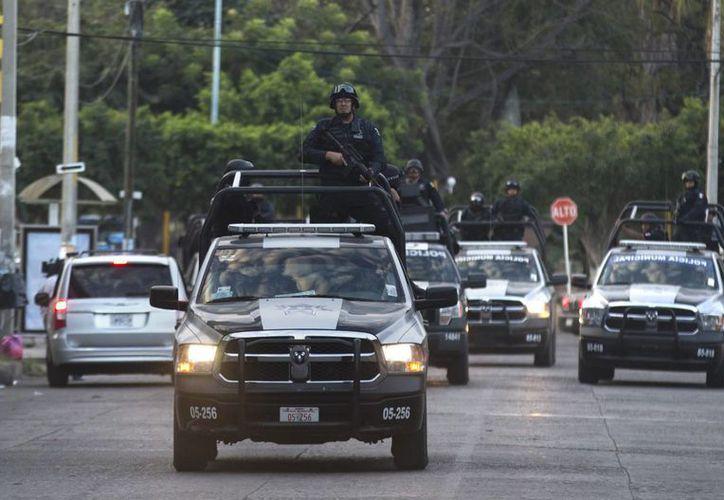 Los Caballeros Templarios han realizado varias emboscadas contra policías federales. (Agencias)
