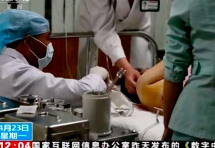 La televisión estatal mostró imágenes de los accidentados. (Internet)