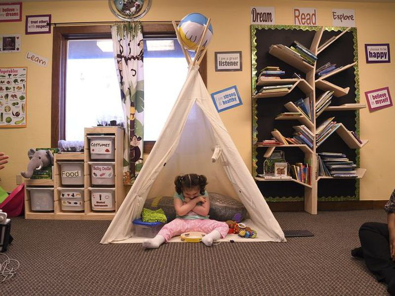 Addelyn Patrick, 5, sits inside a teepee in the playroom at Realm of Caring in Colorado Springs, Colo.