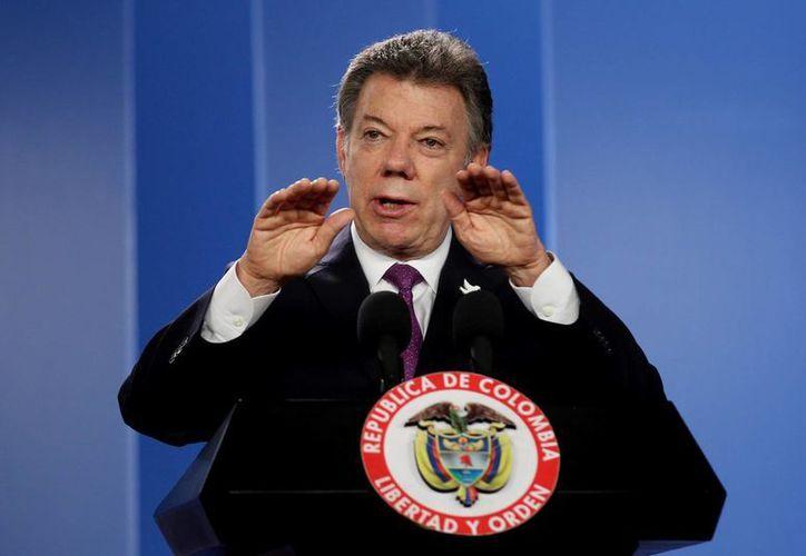 El presidente Juan Manuel Santos había informado que el militar Cristian Moscoso sería liberado el día 20 de julio. (EFE/Archivo)