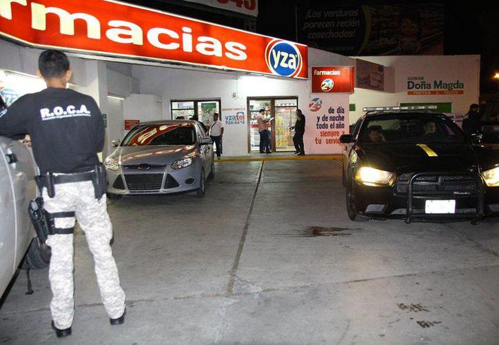 Elementos de la SSP y de la Policía Ministerial llegaron al sitio para las indagaciones. (Martín González/Milenio Novedades)