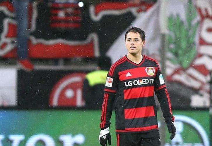 El delantero mexicano lleva un registro de 13 goles en 16 partidos con el Bayer Leverkusen, además fue nombrado jugador del mes en la Bundesliga, por tercer mes consecutivo. (AP)